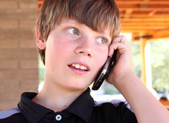 electronics_teen-on-cellphone_146801320-thumb-240xauto-4970